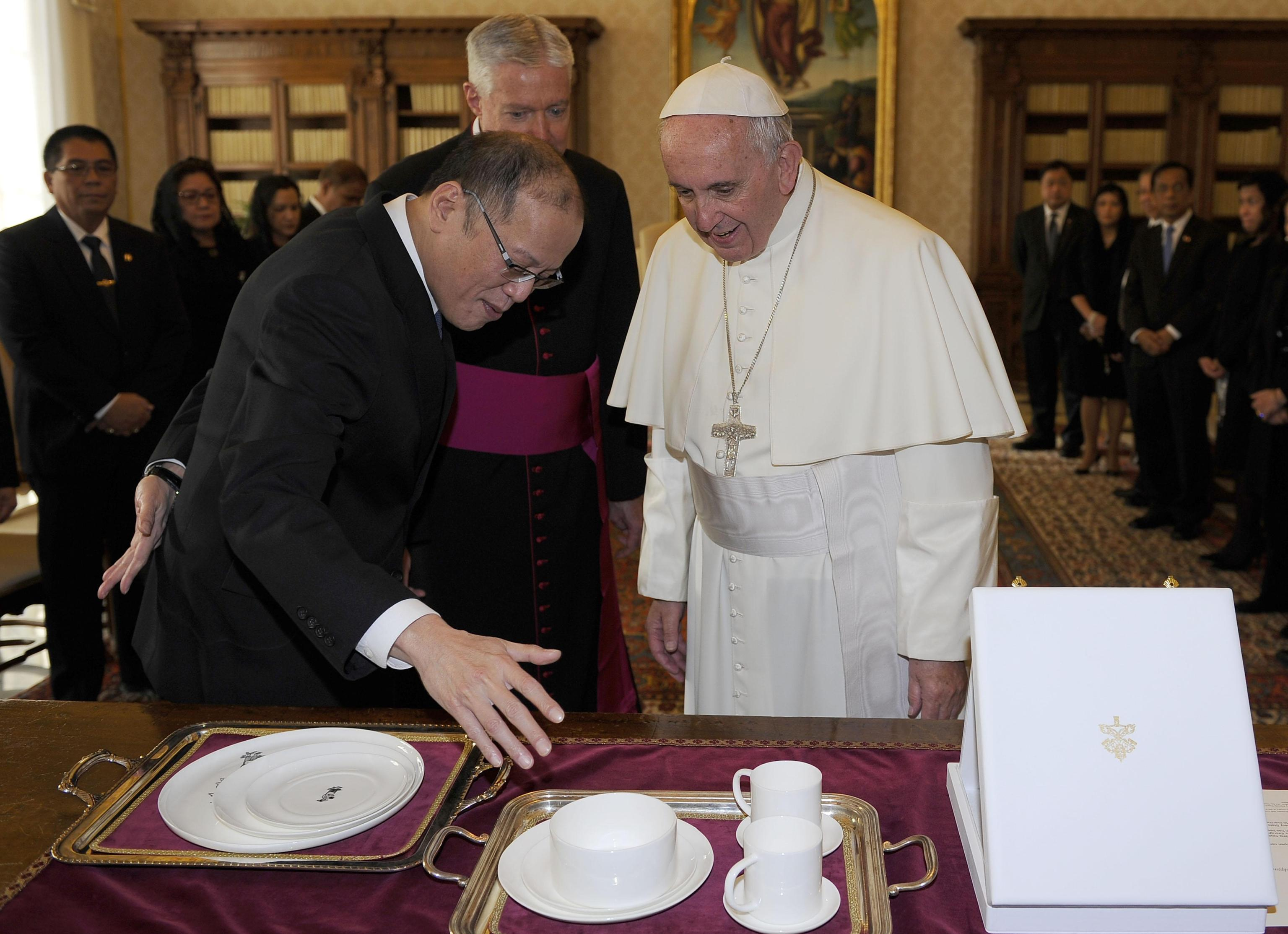 Pope Francis speaks with President Benigno S. Aquino III of the Philippines  during a private audience at the Vatican City