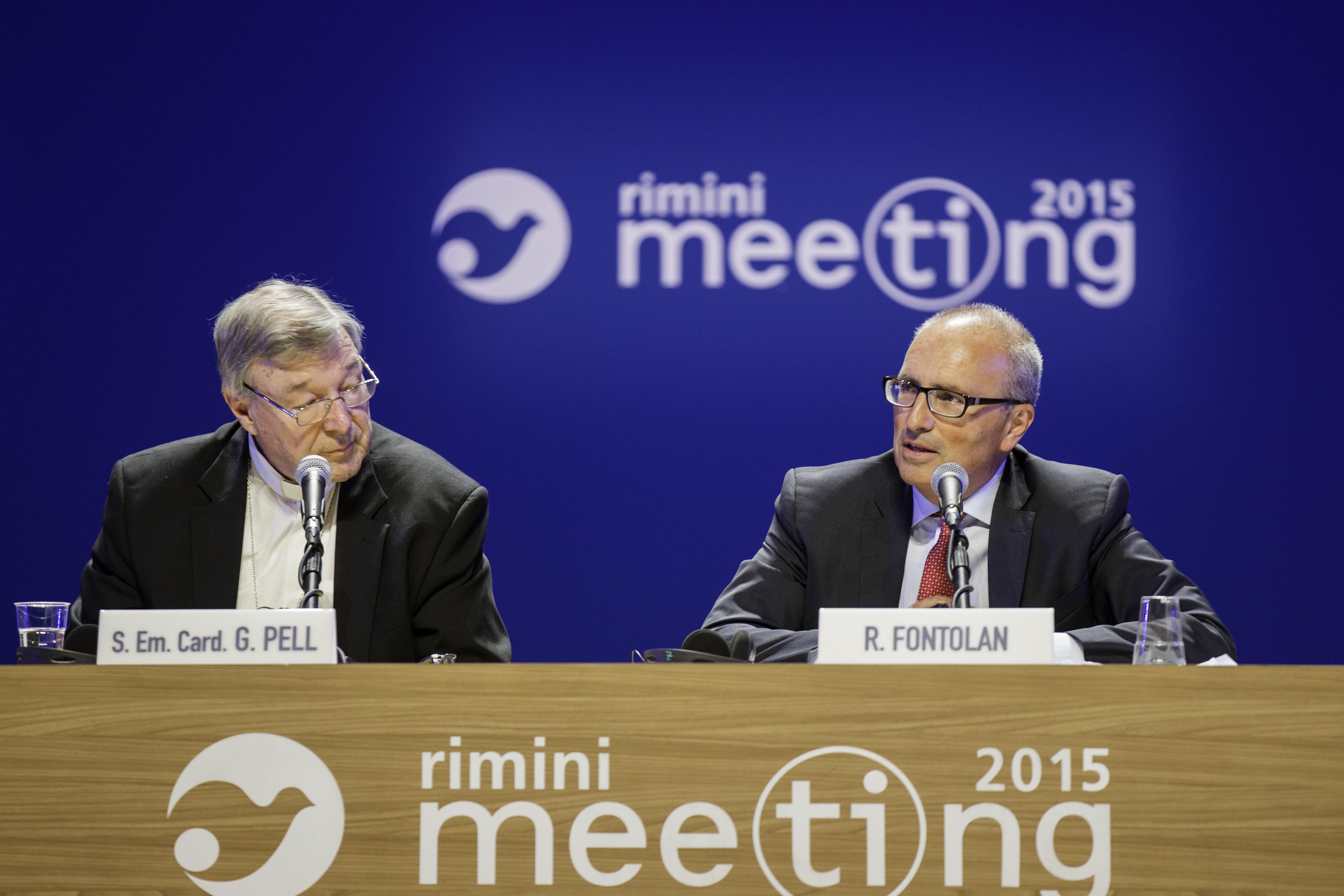 Cardinal George Pell (L) at the Meeting of Rimini 2015