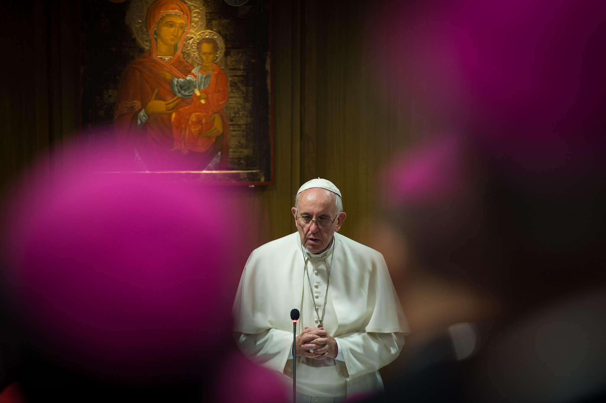 Pope Francis praying during the Synod of Bishops in the Vatican