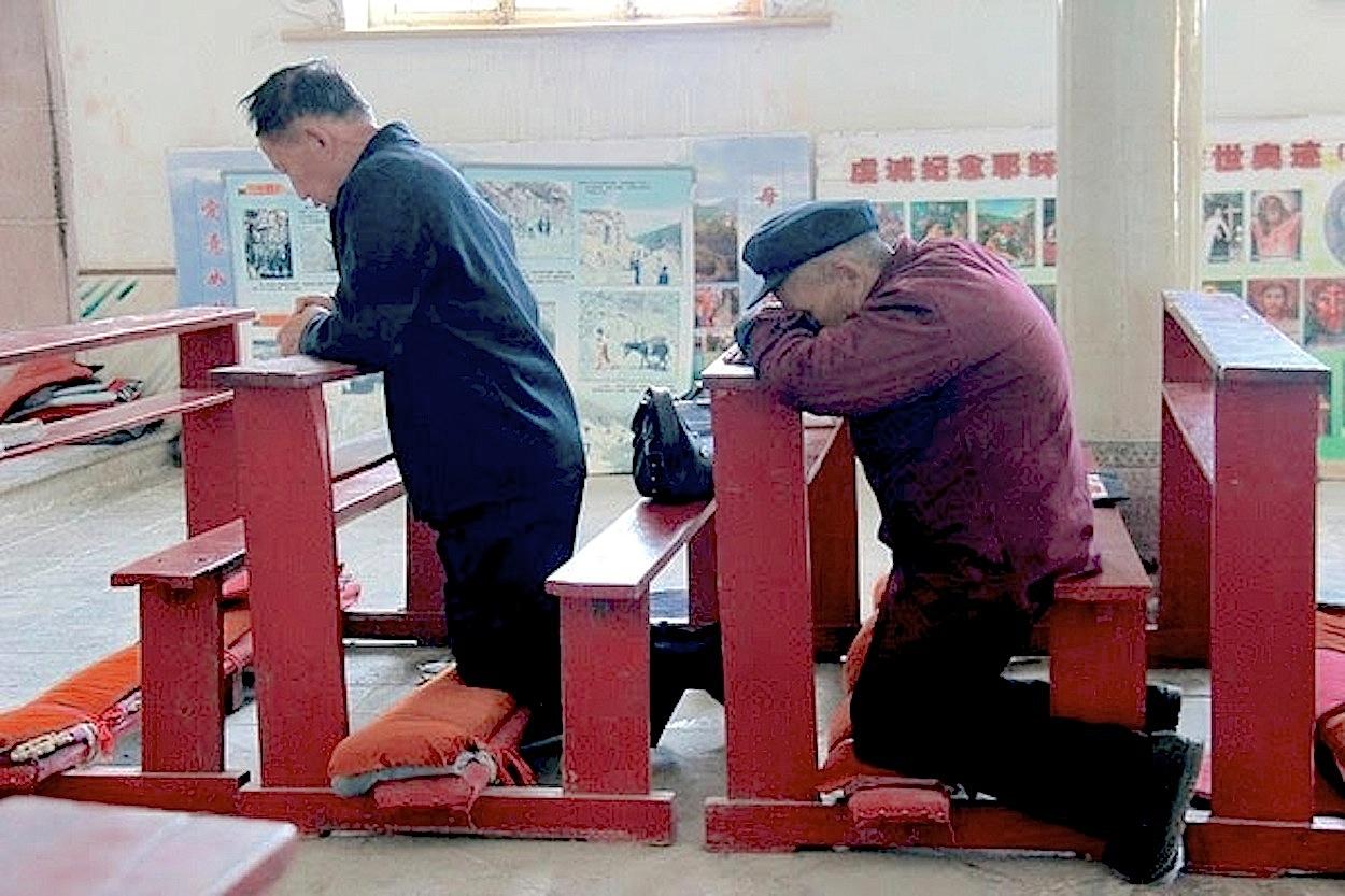 Catholics praying in China