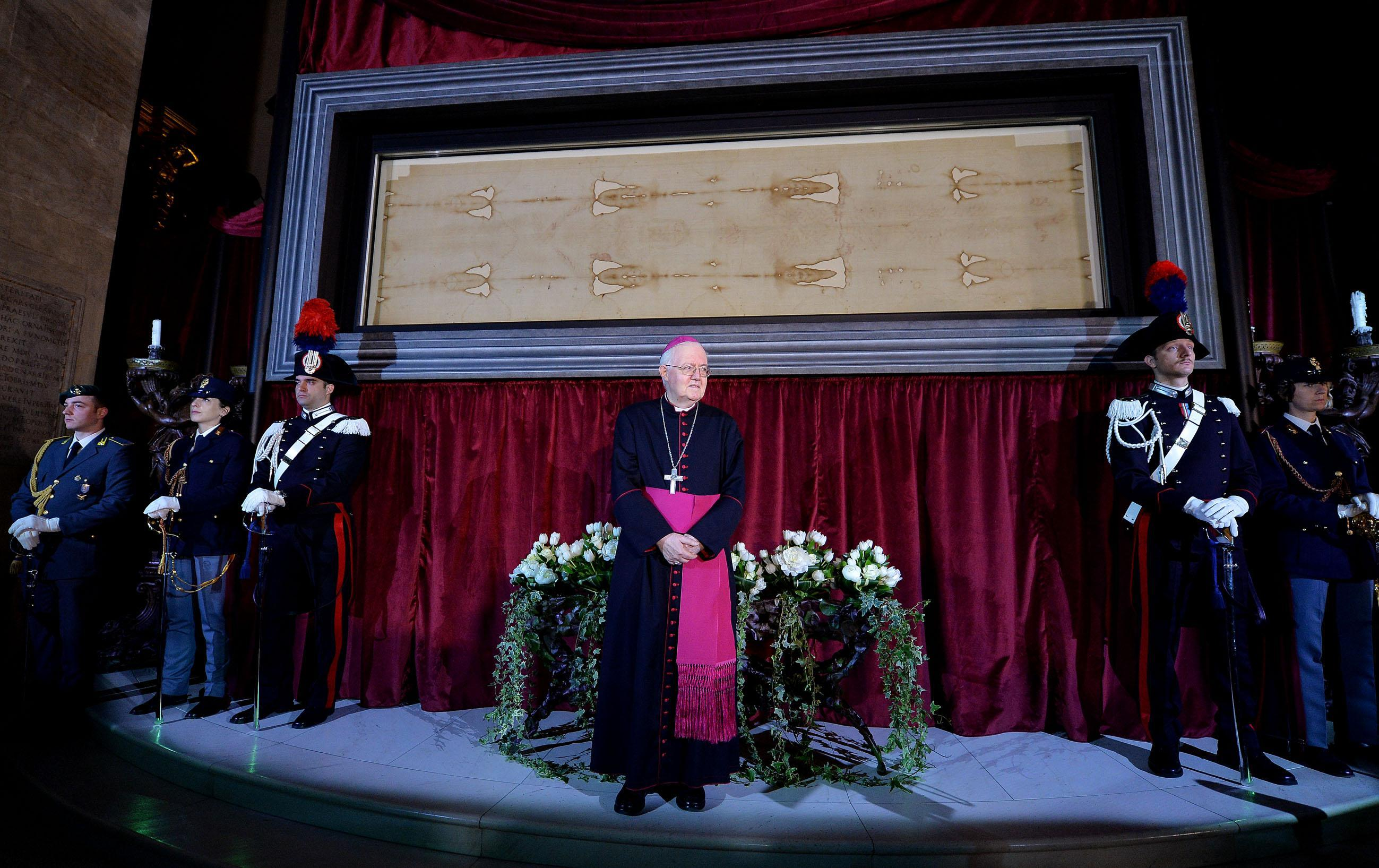 Archbishop Cesare Nosiglia presents the Holy Shroud on display during a preview for the press at the Cathedral of Turin