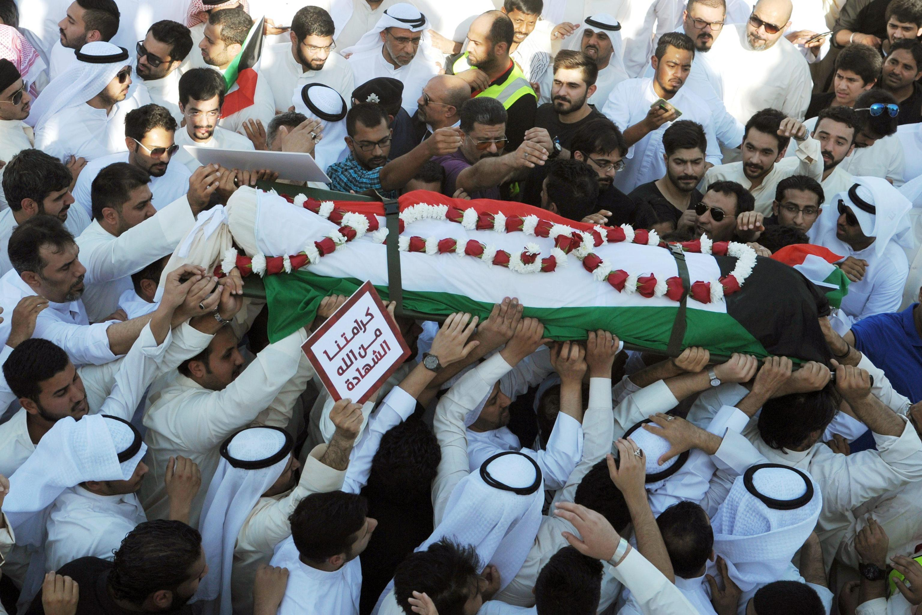 Funeral procession for victims of suicide bombing in a Shi'ite mosque in Kuwait City