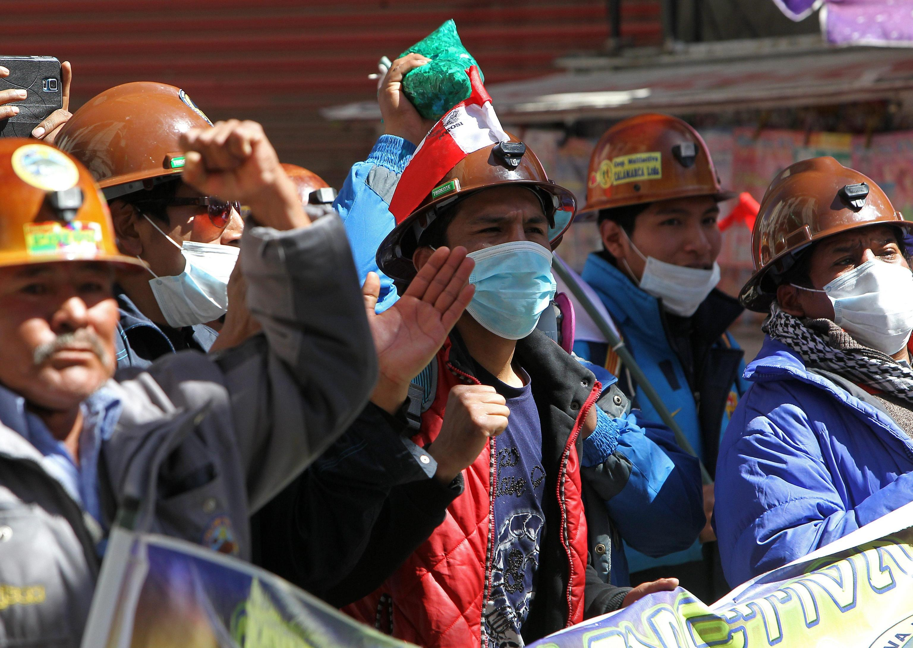 Thousands of miners shout slogans during a protest at Murillo square
