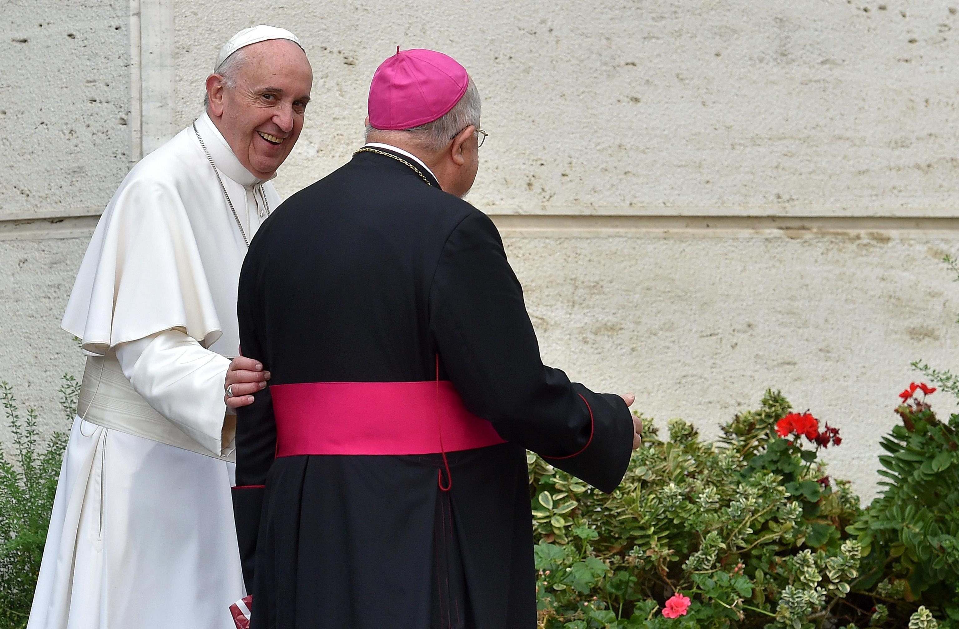 Pope Francis leaves at the end of the morning session of the XVI Ordinary Meeting of the Synod of Bishops at the Synod Hall