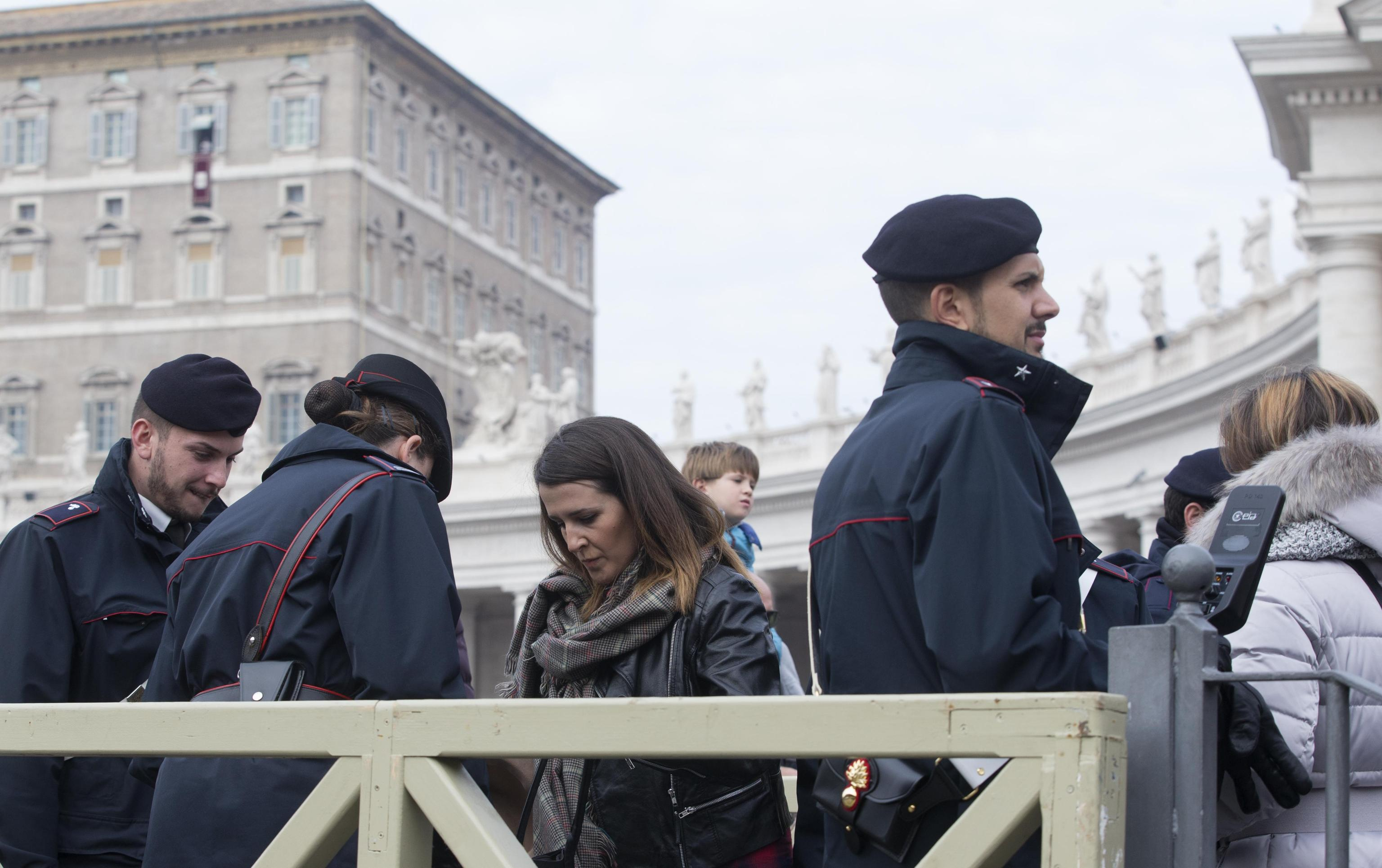 Italian Carabinieri check faithful with metal detector devices as they enter Saint Peter's Square. Vatican City