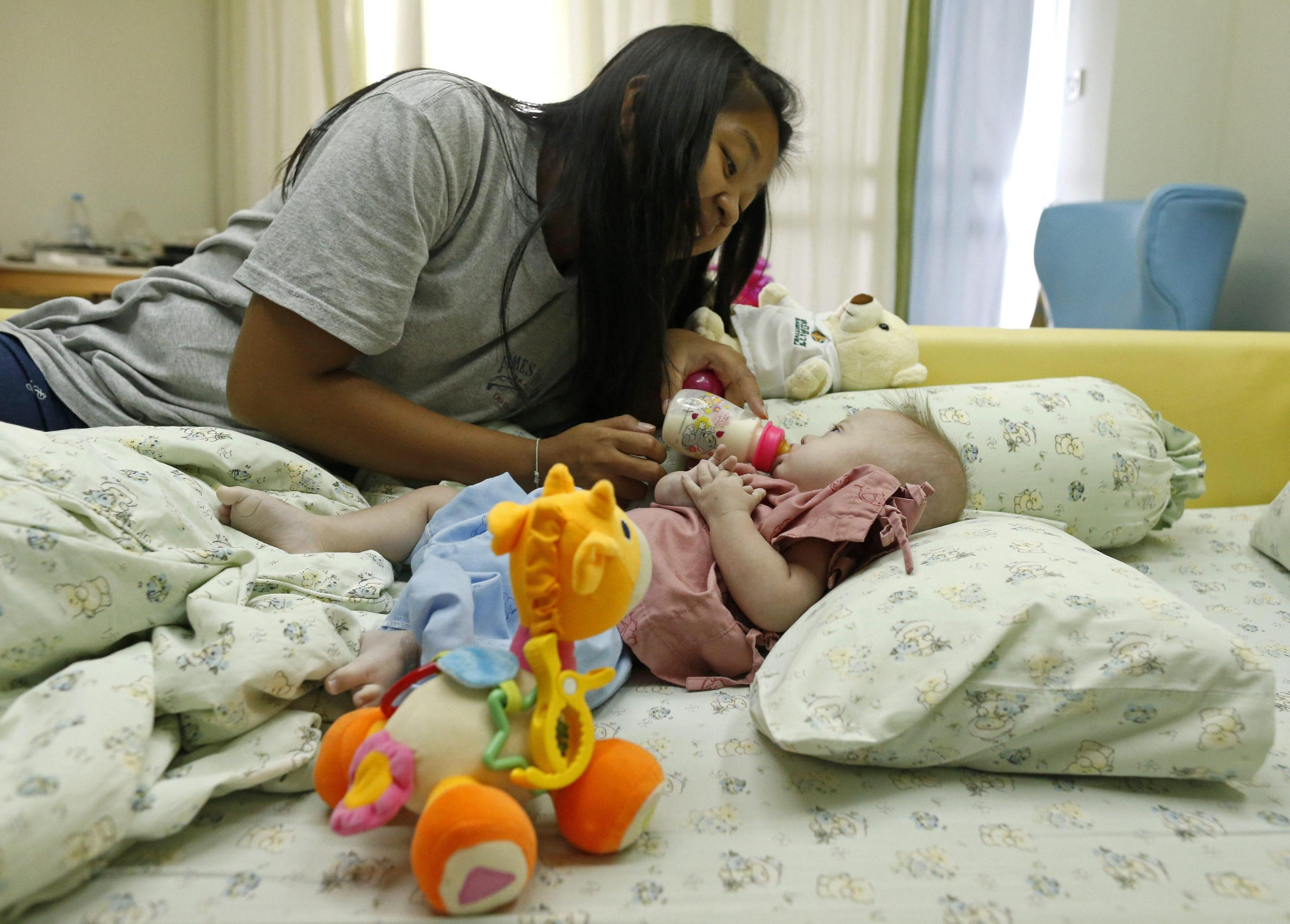 Thai surrogate mother Pattharamon Janbua with her seven-month-old Down's Syndrome baby