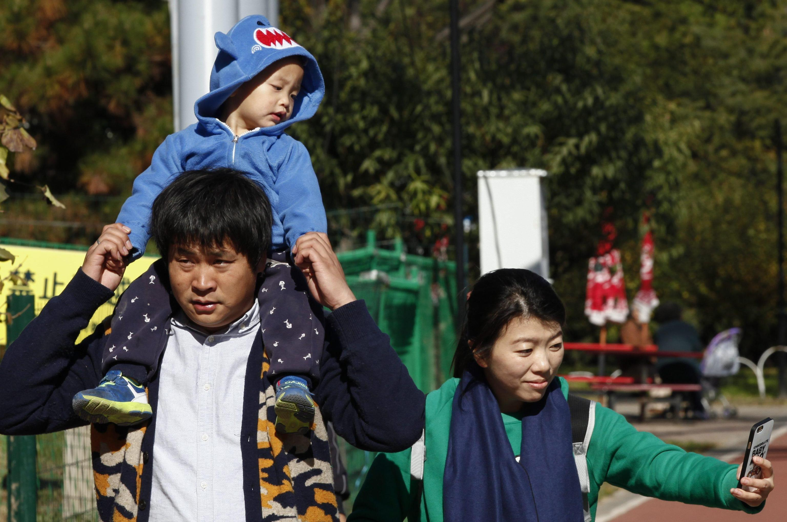 A Chinese family tours a public park in Beijing