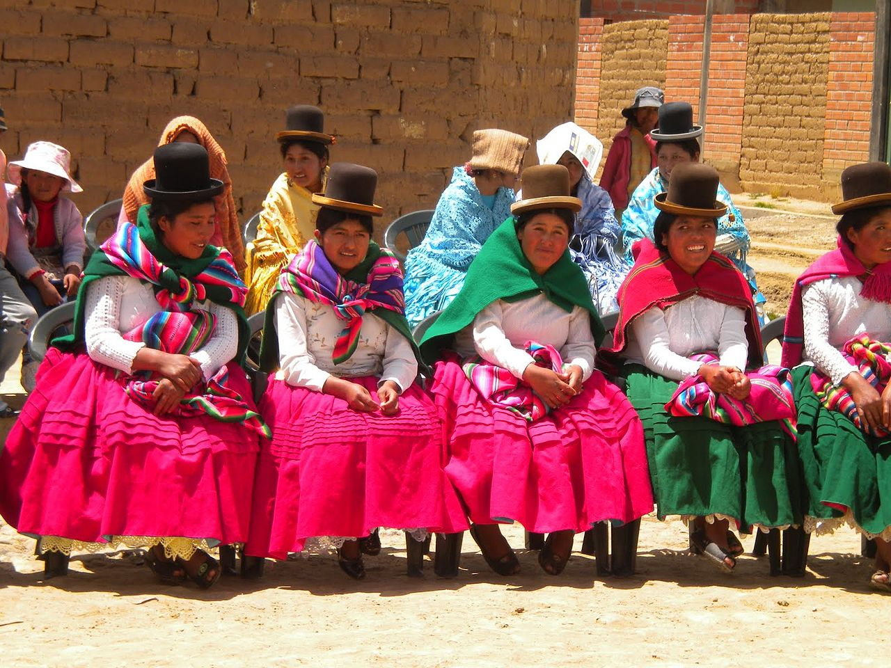 Aymara women dressed in their colourful traditional clothing
