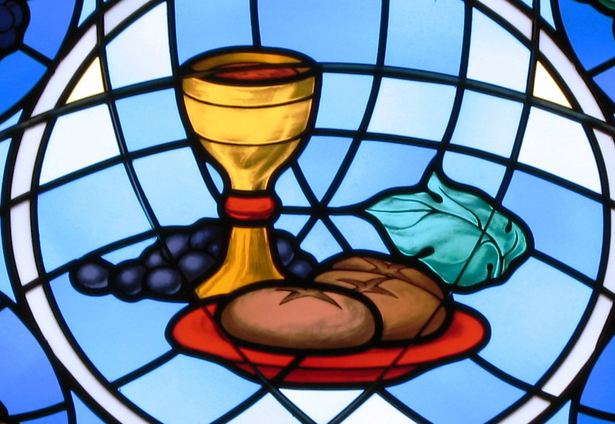 Bread and Wine for the Eucharist. Stained Glass in the St. Michael the Archangel Parish