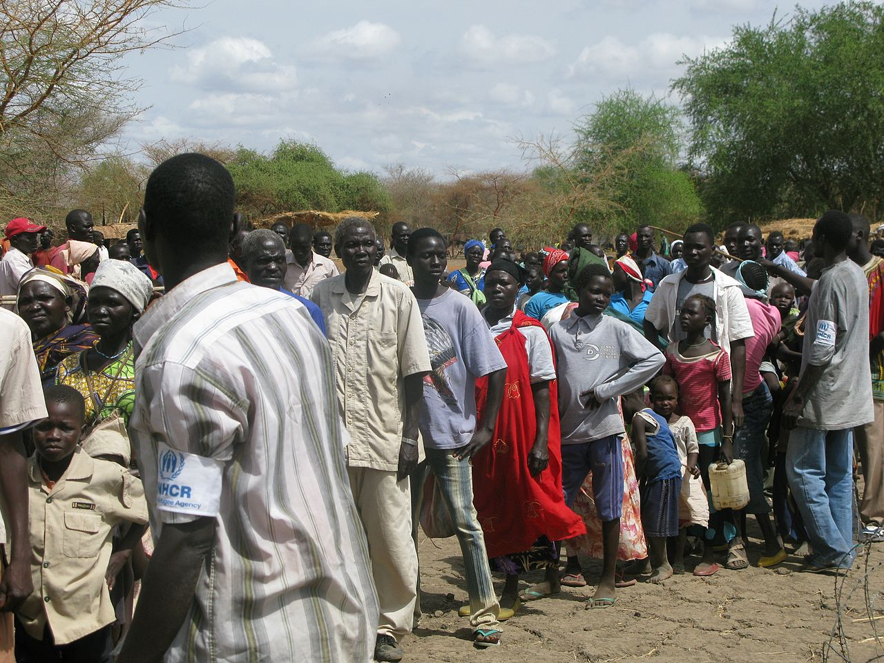 UNHCR staff assist refugees arriving at the Doro camp in South Sudan