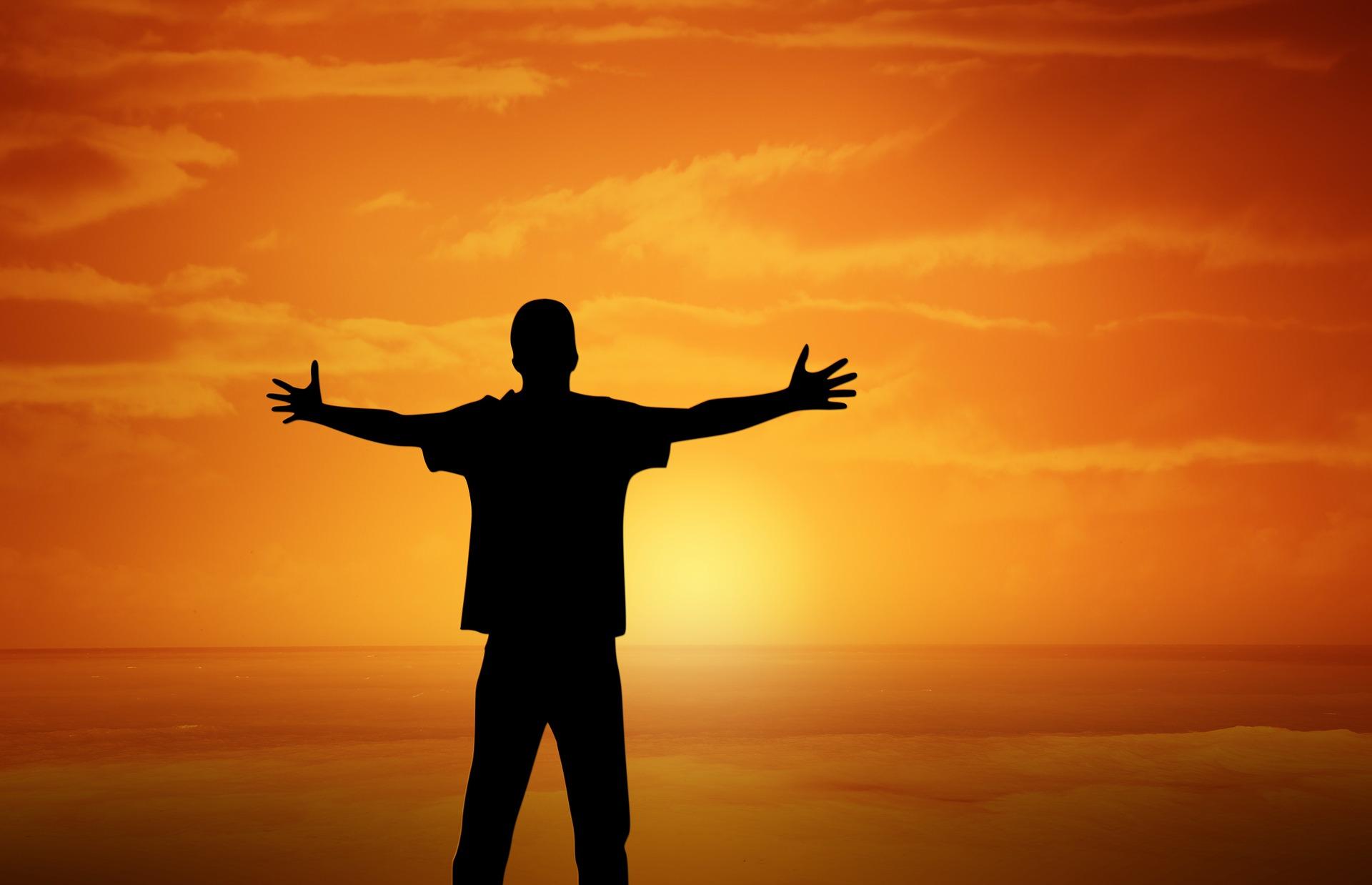 Joyful person at sunset