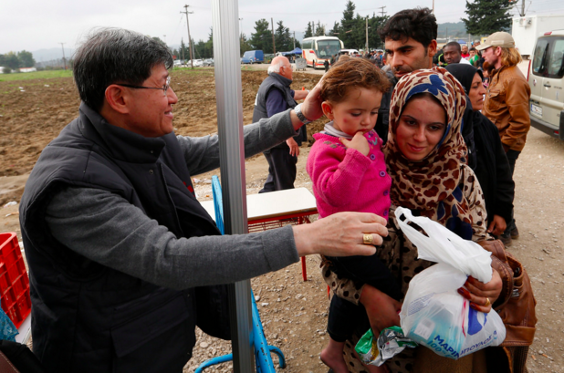 Card. Tagle with refugees